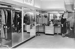 Interior of women's clothing store, circa 1949. Paul Henderson, HEN.00.B1-130.