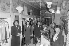 Women inside clothing store, circa 1953. Paul Henderson, HEN.00.B1-132.