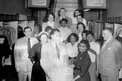 Men and women presenting plaque to Samuel L. Hendin of Hendin's clothing store, circa 1952. Paul Henderson, HEN.00.B1-142.