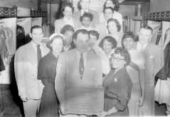 Men and women presenting plaque to Samuel L. Hendin of Hendin's Hollywood Fashions clothing store, circa 1952. Paul Henderson, HEN.00.B1-143.