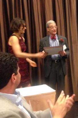 Dr. Belzer accepting award