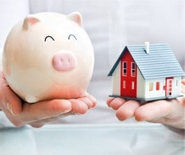 Hands holding a piggy bank and a house - Link to Mortgage