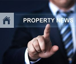 Closeup of a professional's hand clicking on the Property News link - Link to HFG Newsroom