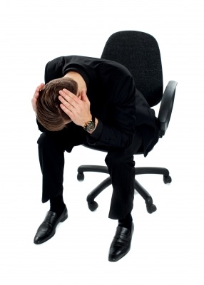 Frustrated man on chair