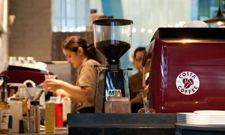 A barista at work in Costa Coffee.