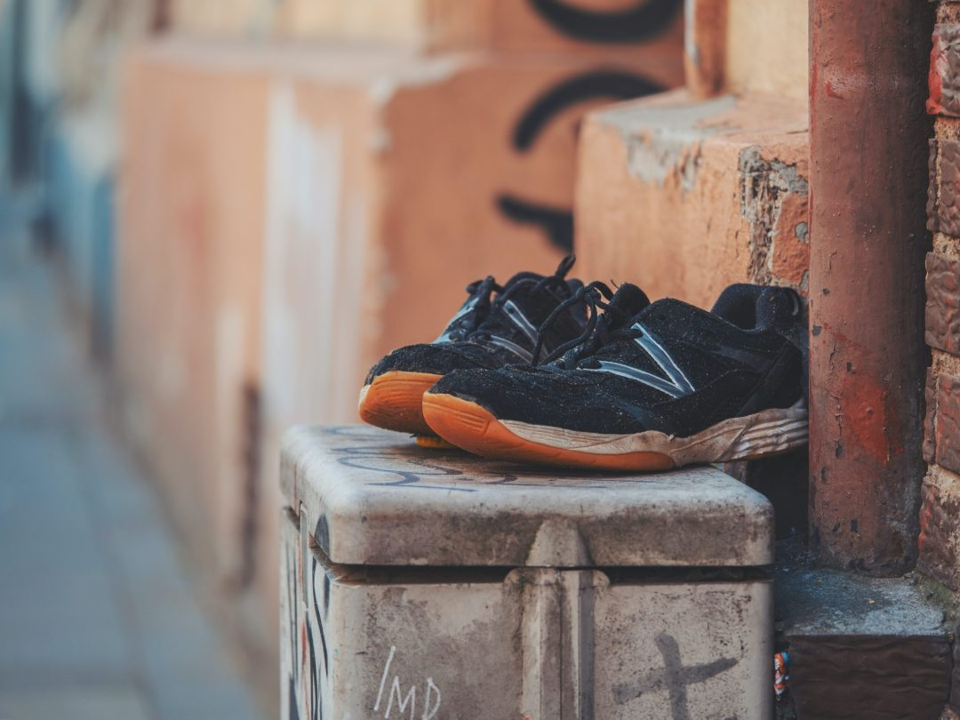 Old pair of shoes sitting an alley - royalty free image