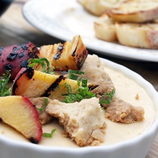 Chai panna cotta with grilled peaches, shortbread, and mint