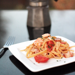 Tomato, shrimp, and bacon fettuccine