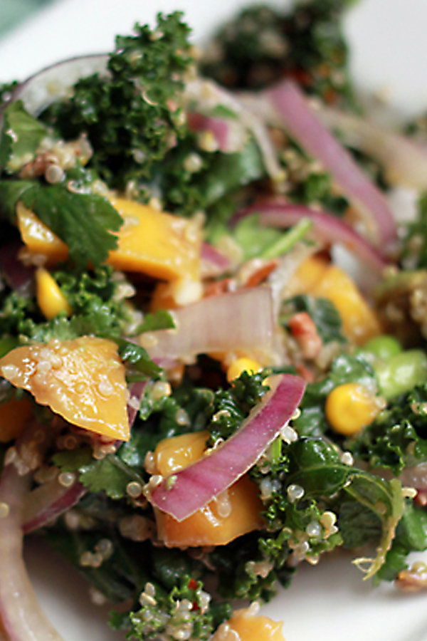 Vegan kale, quinoa, and mango salad