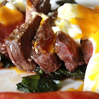 Wilted kale and steak salad with a poached egg