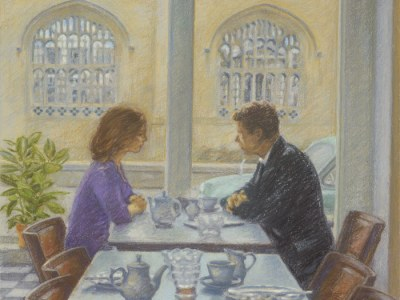 A couple having tea in a cafe across the street from a Cathedral.