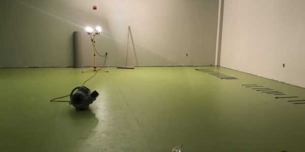 The HEPL green flooring in an Ignite program room is drying.