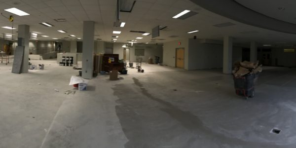 A panoramic view of Ignite. To the right, the flooring is getting ready to be installed.