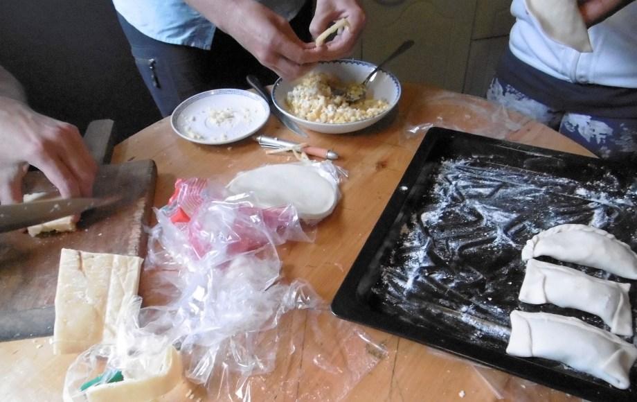 hands on empanadas