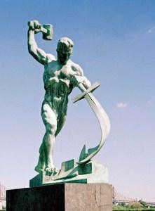 Man beating swords into plowshares