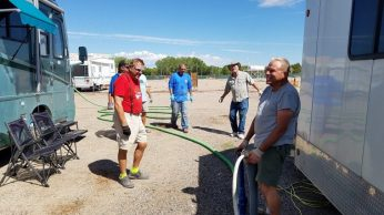 "The ""Poop Team"" working with the pump truck to drain our waste tanks (twice weekly)"
