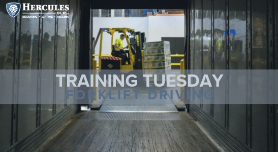 forklift operator driving in warehouse