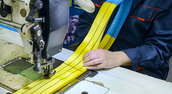industrial rigging and lifting sling being sewn
