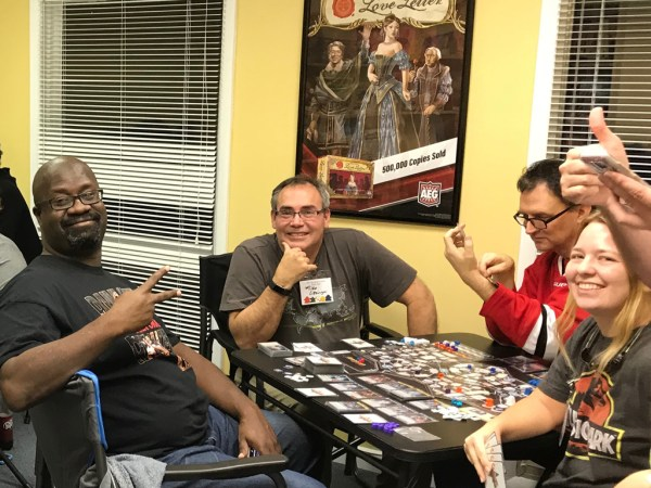Gamers playing Clank! In! Space! in the Gate Room