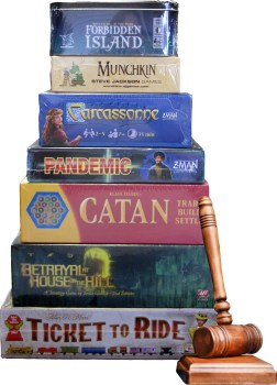 stack of games and auction gavel