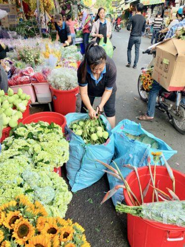 Vendor opening deliveries at Ho Thi Ky flower market