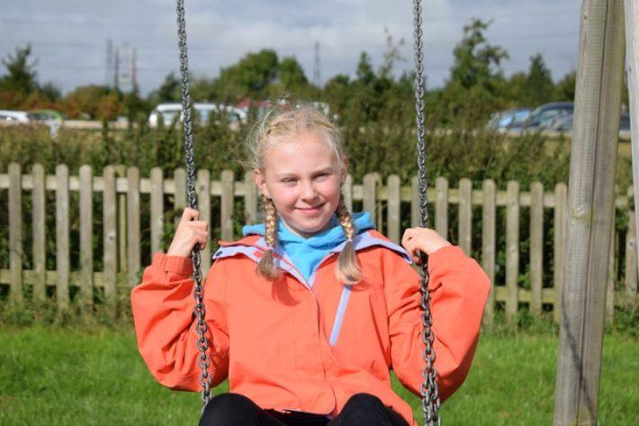 Imogen on the swings