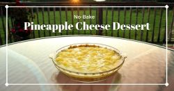 Pineapple cheese dessert in pie plate on outdoor table at sunset