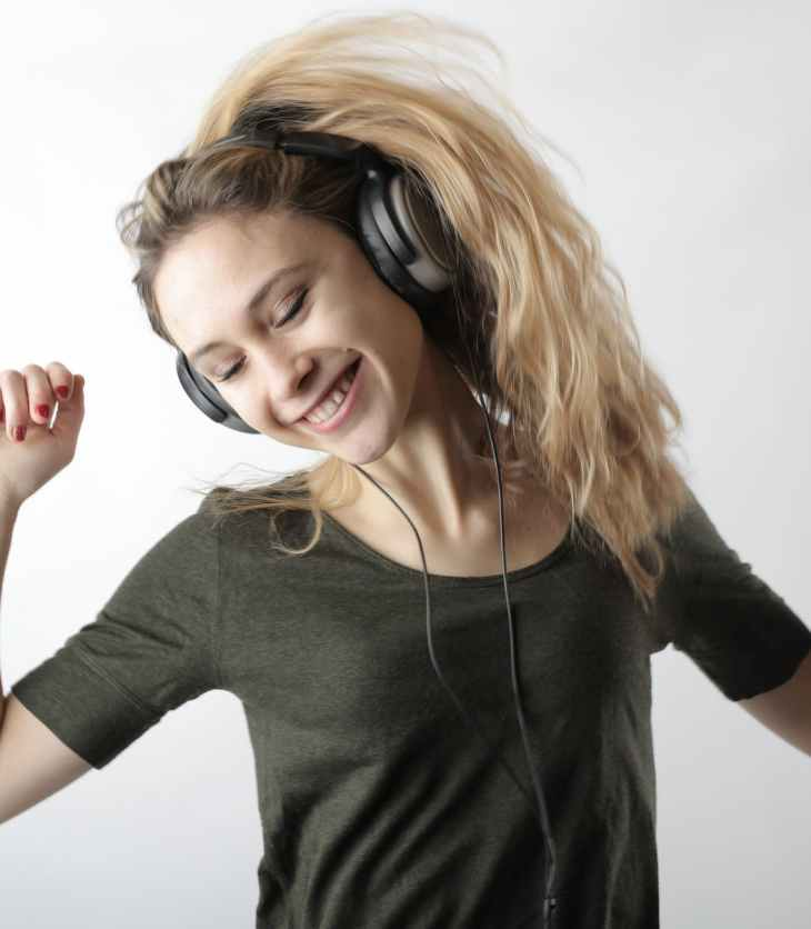 woman happily listening to music
