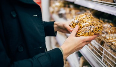 woman buying pretzels