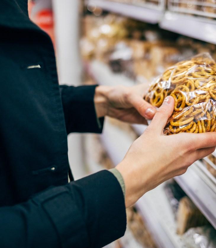 woman buying pretzels