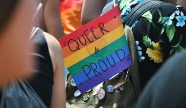 queer and proud rainbow sign