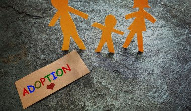 paper dolls and adoption sign