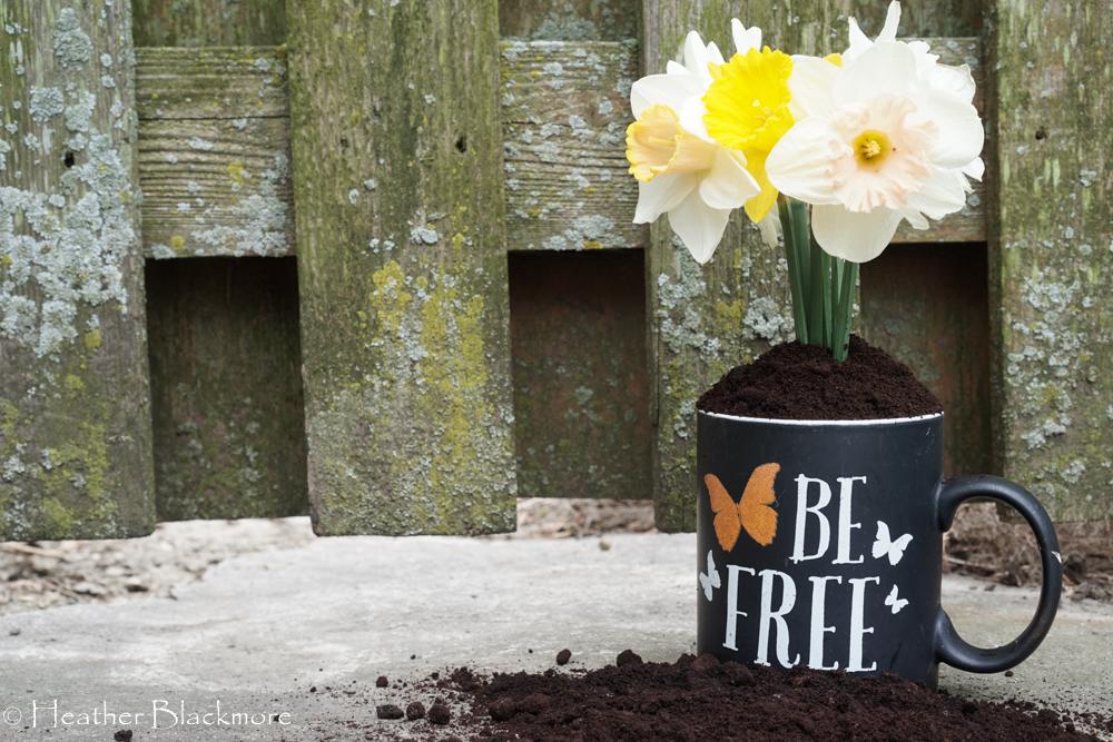 Coffee mug with grounds anf flowers