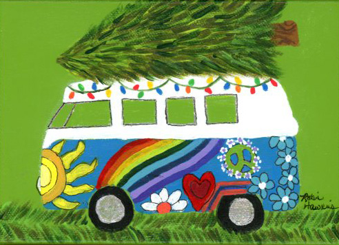 A boldly painted VW bus decorated with lights and hauling a christmas tree on the roof.