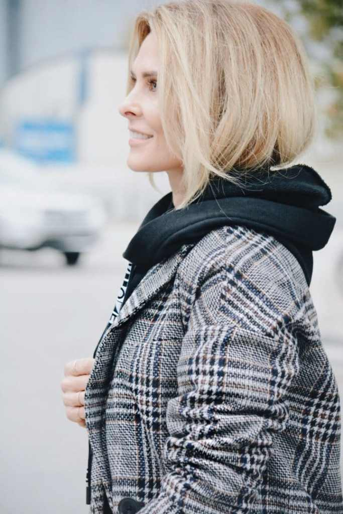 Black Hoodie Styled with Plaid Jacket - Her Fashioned Life