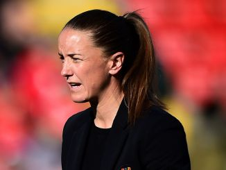 Manager Casey Stoney looks on from the sideline.