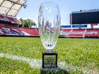 The NWSL Challenge Cup trophy sits on the pitch of Zions Bank Stadium.