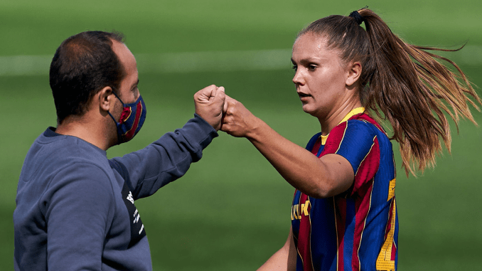 Lluis Cortes and Lieke Martens of FC Barcelona bump fists after the game against Real Madrid.