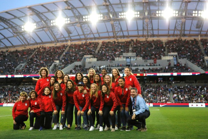 Members of the 1999 FIFA World Cup championship team pose for a photo at half time of the United States Women's National Team vs. Belgian Women's National Team game at Banc of California Stadium on April 07, 2019 in Los Angeles, California.