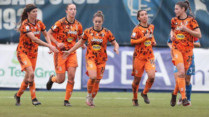 Lisa Boattin of Juventus celebrates with her teammates after scoring.