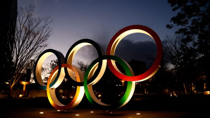 Olympic Rings are seen near the National Stadium in Tokyo, Japan.