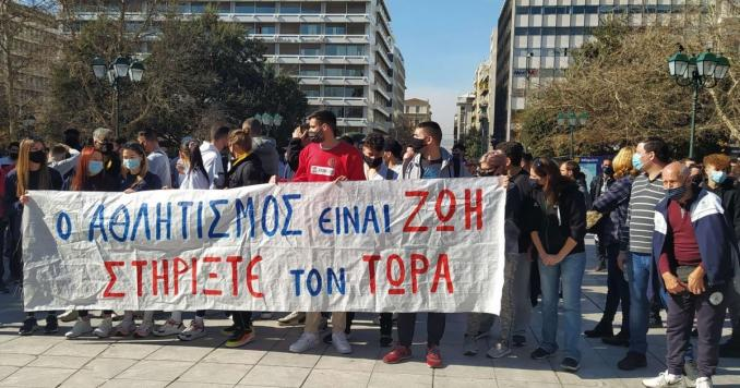 Protesters hold a banner during a peaceful rally in Athens.