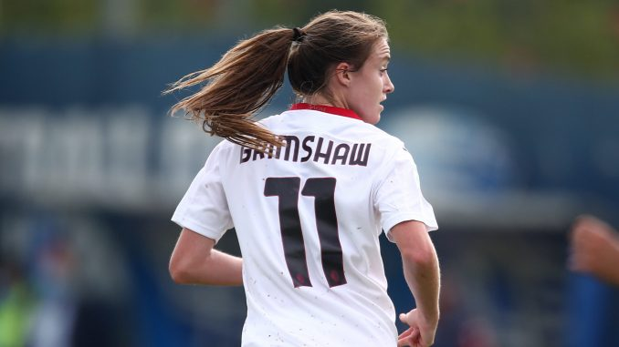 Christy Grimshaw has her back to the camera while running down the pitch.
