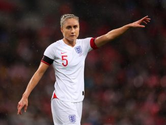 Steph Houghton of England points directions.
