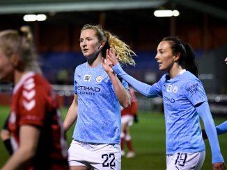 Manchester City's Sam Mewis and Caroline Weir celebrate Weir's goal.
