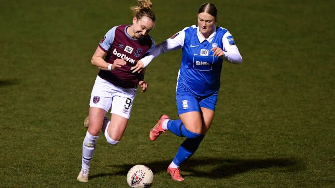 Martha Thomas of West Ham United and Ruby Mace of Birmingham City battle for the ball.