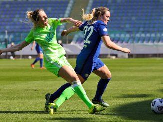 Wolfsburg's Kathrin Hendrich and Chelsea's Erin Cuthbert in action.