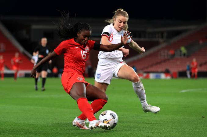 Nichelle Prince and Leah Williamson battle for the ball.