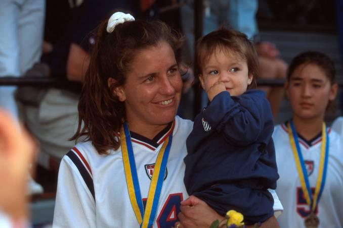 Joy Fawcett celebrates with her child.
