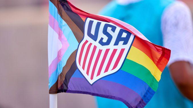 A pride-themed USA corner flag.